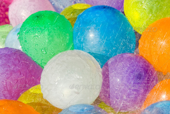 Close view of rainwater falling over colored ballons - Stock Photo - Images