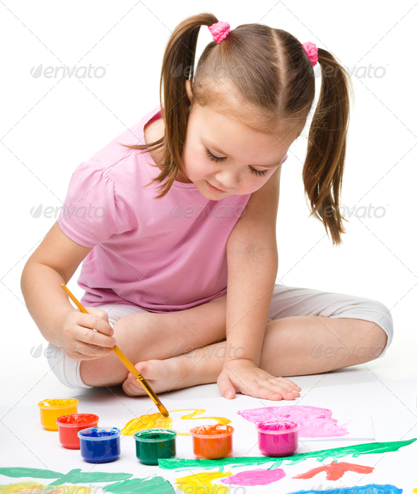 Cute cheerful child play with paints - Stock Photo - Images