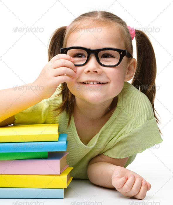 Cute little girl with books - Stock Photo - Images