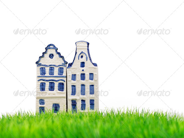 Two miniature Amsterdam canal houses on grass - Stock Photo - Images