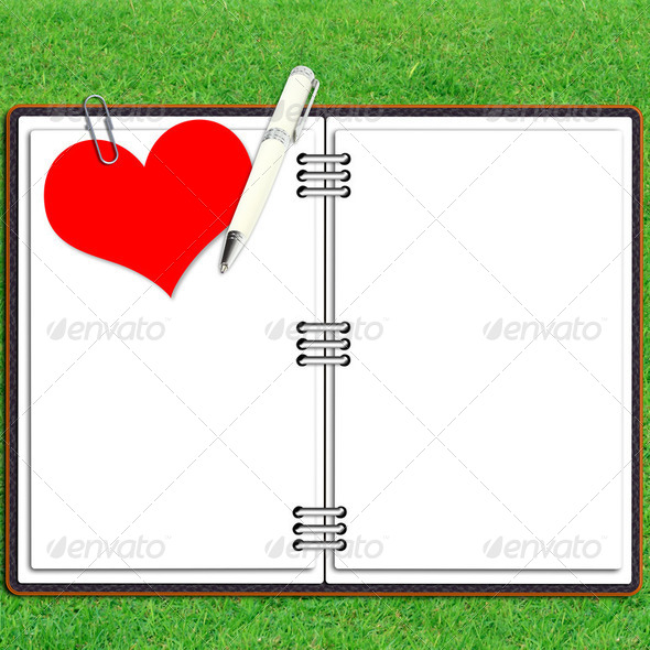 Paper note book leather cover with pen and red heart paper over grass - Stock Photo - Images