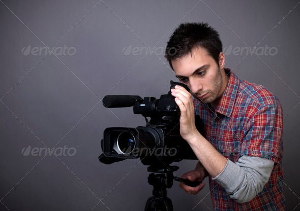 Young man with video camcorder - Stock Photo - Images
