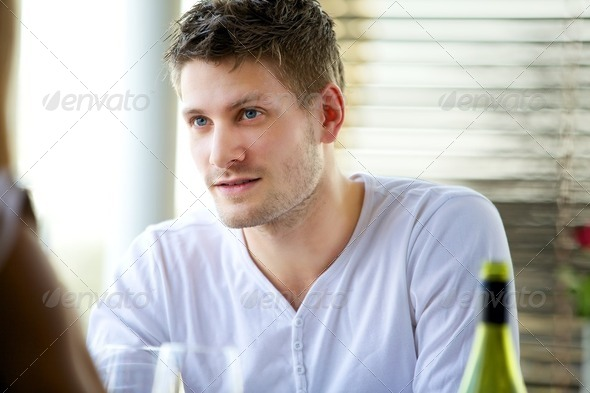 Attractive Guy Seriously Listening - Stock Photo - Images
