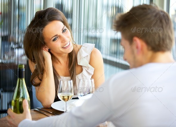Dating Couple at a Restaurant - Stock Photo - Images