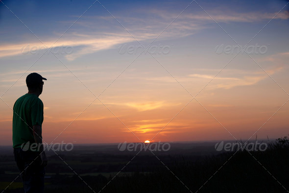 Man and sunset - Stock Photo - Images