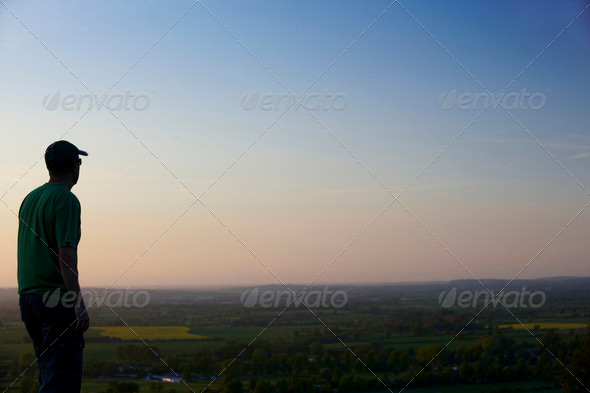 man at dusk - Stock Photo - Images