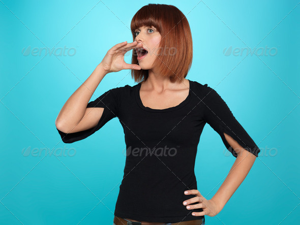 pretty woman shouting with hand at mouth - Stock Photo - Images
