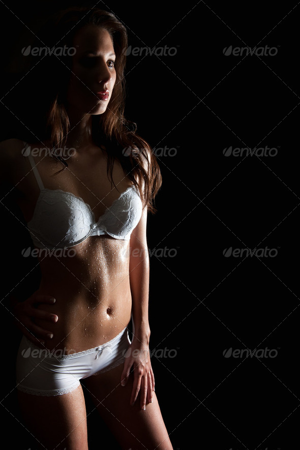 Portrait of a beautiful woman in erotic underwear - Stock Photo - Images