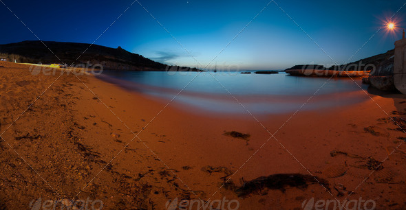 Panorama of Gnejna Bay at dusk - Stock Photo - Images