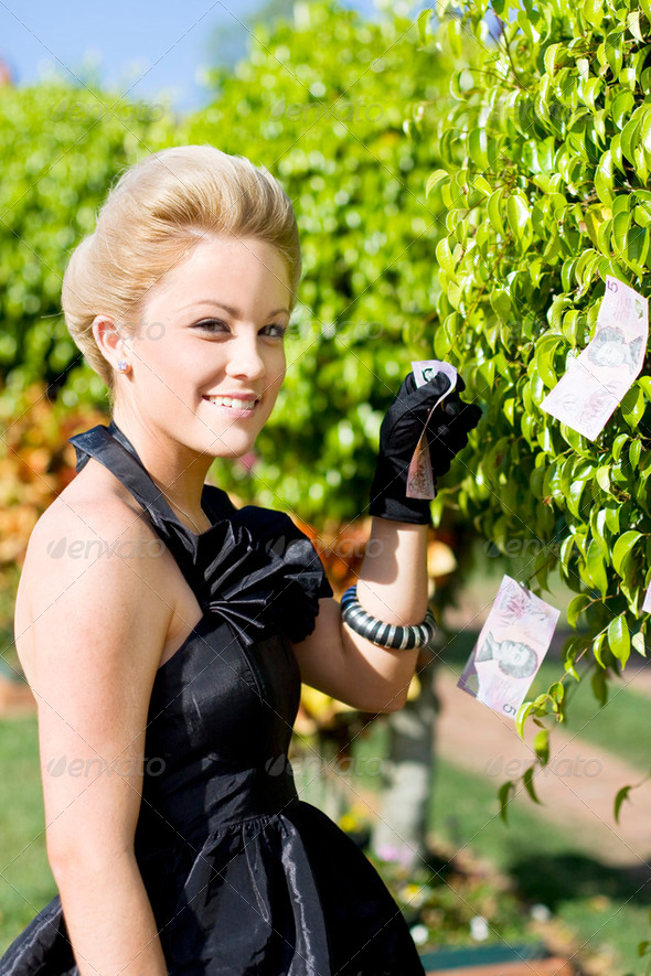 Money Tree Woman - Stock Photo - Images