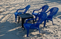 Black Table and Blue Chairs on the Beach - PhotoDune Item for Sale