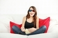 Beautiful young woman watching TV in 3d glasses - PhotoDune Item for Sale