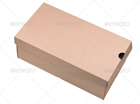 Closed shipping cardboard box isolated on white - Stock Photo - Images