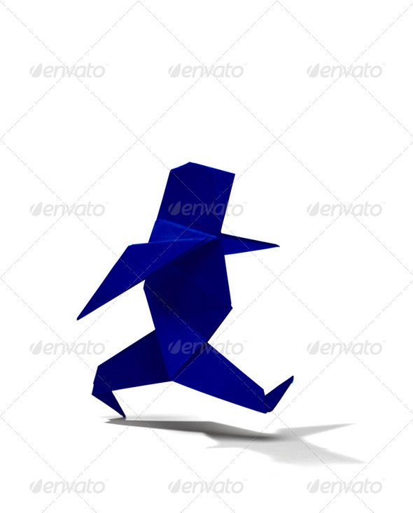 Man walking in origami - Stock Photo - Images