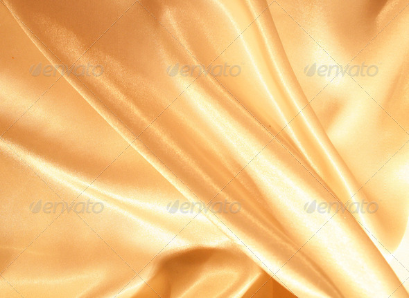 Smooth elegant golden silk as background - Stock Photo - Images