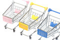 Shopping carts on white, closeup - PhotoDune Item for Sale