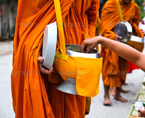 Offer food to monk on early morning - Stock Photo - Images