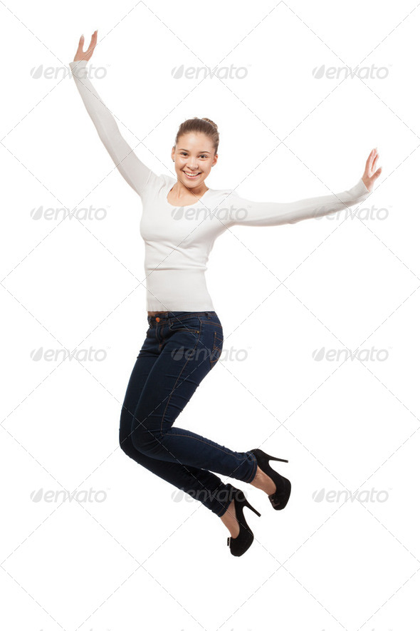 Casual woman jumping in joy. isolated over a white background - Stock Photo - Images