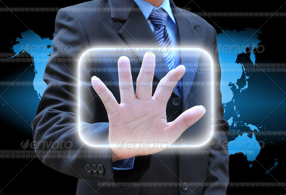 businessman hand pushing button on a touch screen interface - Stock Photo - Images