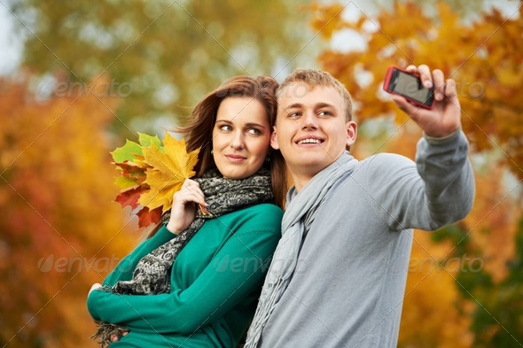 Couple at autumn outdoors - Stock Photo - Images