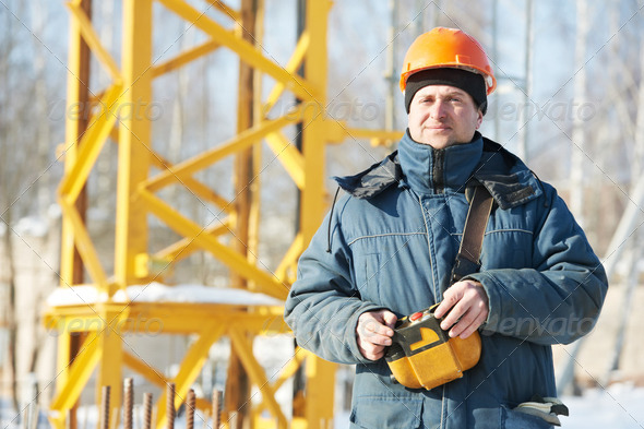 Builder with tower crane remote control equipment - Stock Photo - Images