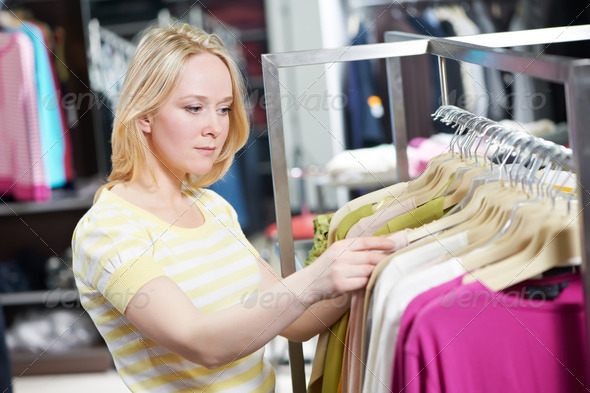 Young woman at clothes shopping store - Stock Photo - Images