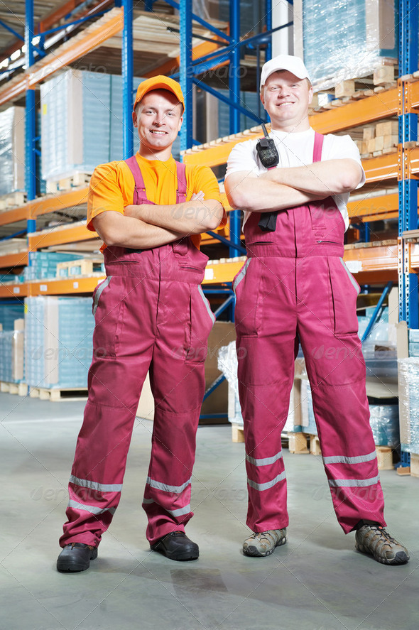young manual workers in warehouse - Stock Photo - Images