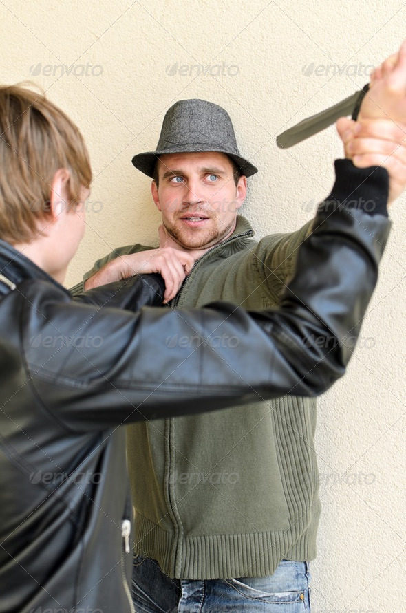 Burglar is trying to kill man by knife. - Stock Photo - Images