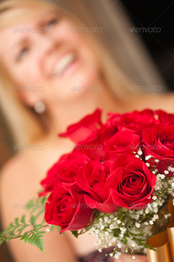 Surprised Attractive Blonde Woman Accepts Gift of Red Roses. - Stock Photo - Images