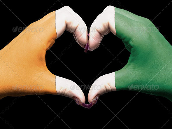 Heart and love gesture by hands colored in ivory coast flag for - Stock Photo - Images
