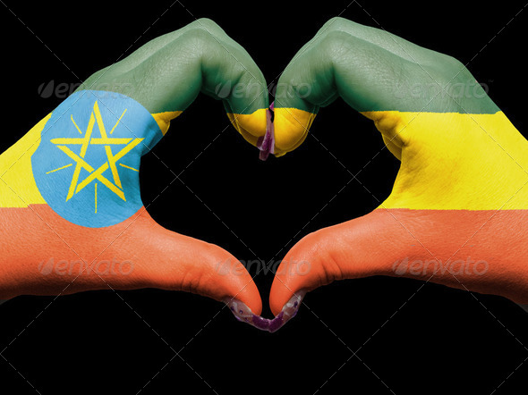 Heart and love gesture by hands colored in ethiopia flag for tou - Stock Photo - Images