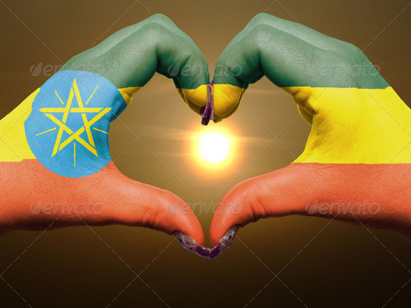 Heart and love gesture by hands colored in ethiopia flag during - Stock Photo - Images