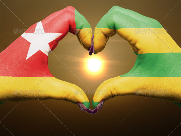 Heart and love gesture by hands colored in togo flag during beau - Stock Photo - Images