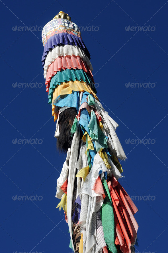 Colorful Tibetan prayer flags pole - Stock Photo - Images