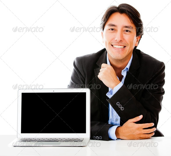 Business man with a laptop - Stock Photo - Images
