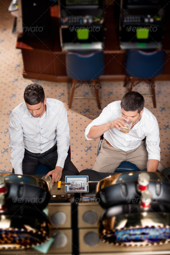 men playing the slot machine - Stock Photo - Images