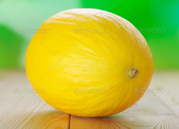 Yellow melons on wooden table - Stock Photo - Images