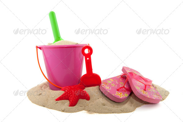 toys in the sand - Stock Photo - Images