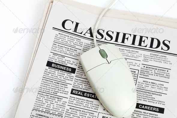 Classified Ad and computer mouse - Stock Photo - Images