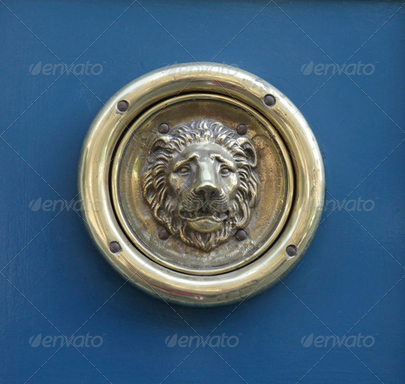 Bronze lionhead door knocker - Stock Photo - Images