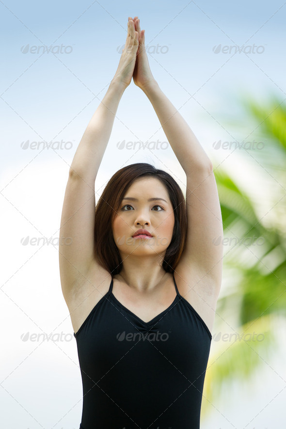 Young Asian woman doing yoga. - Stock Photo - Images