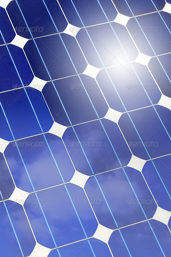Solar panel closeup with sky and sun reflection - Stock Photo - Images