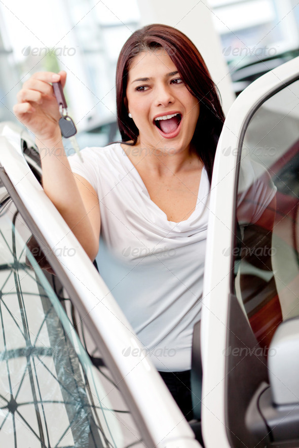 Woman buying a car - Stock Photo - Images