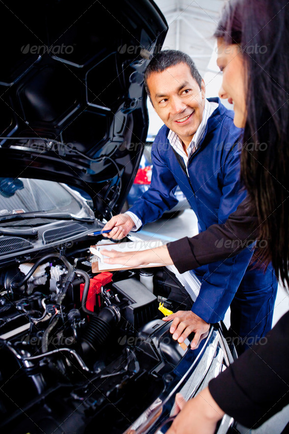 Woman at the mechanic - Stock Photo - Images