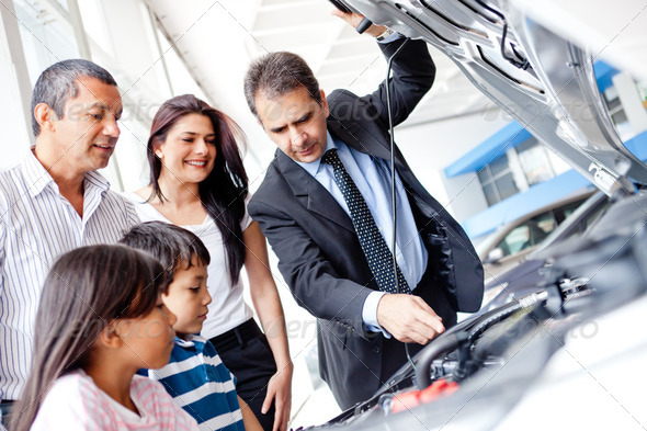 Family buying a car - Stock Photo - Images