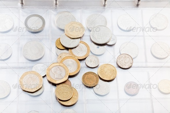 numismatics album with different coins - Stock Photo - Images