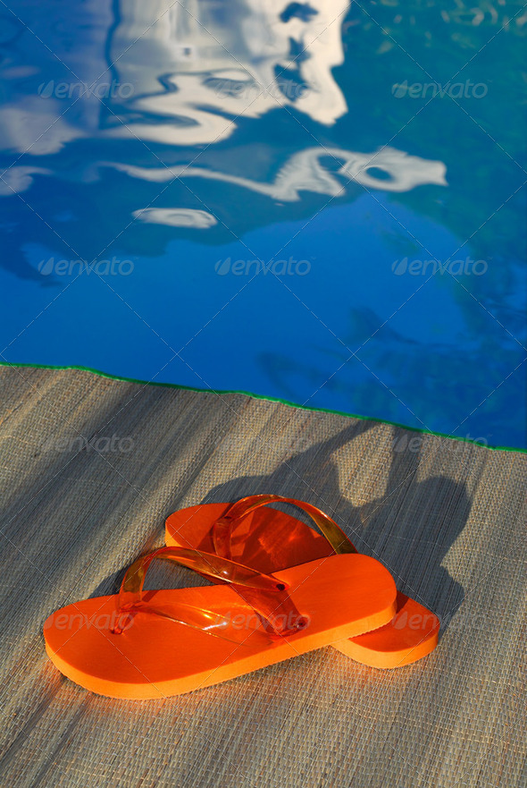 Swimming Pool And Flip Flop Sandals - Stock Photo - Images