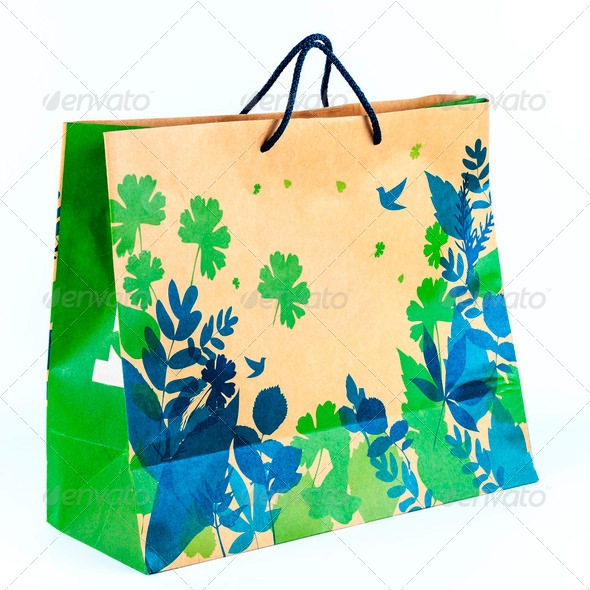 Concept picture of shopping recycle paper bag for save environment - Stock Photo - Images