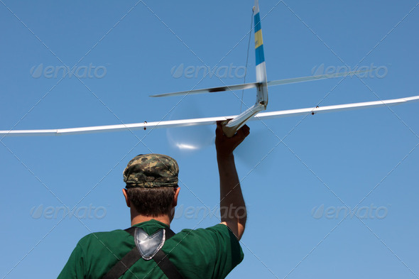Man launches into the sky RC glider - Stock Photo - Images