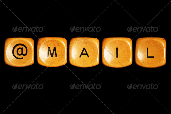 Grunge typewriter keyboard play on  mail words . Isolated on a black background. - Stock Photo - Images